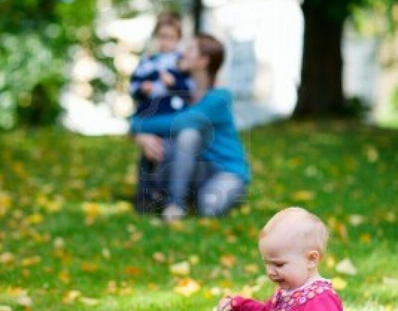 5559268-happy-mother-and-two-kids-spending-time-outdoors-at-sunny-autumn-day